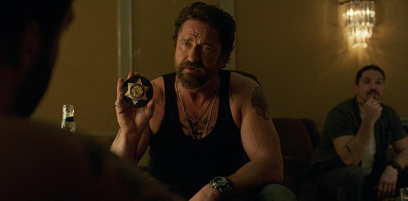 Trailer italiano e locandina per Nella tana dei lupi, cop crime movie con Gerard Butler