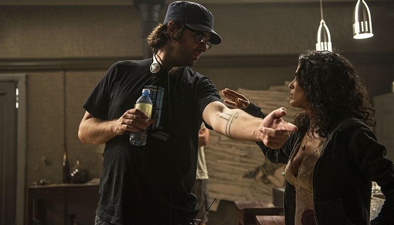 Salma Hayek and Joe Lynch in Everly (2014)