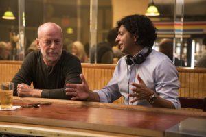 Bruce Willis and M. Night Shyamalan in Glass (2019)