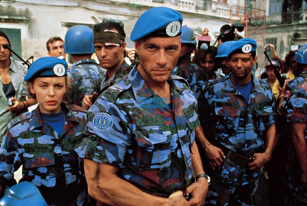 Jean-Claude Van Damme, Kylie Minogue, and Gregg Rainwater in Street Fighter (1994)