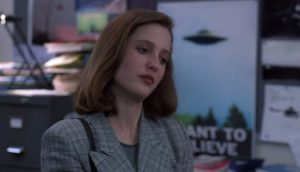 Gillian Anderson poster in pilot X Files (1993)
